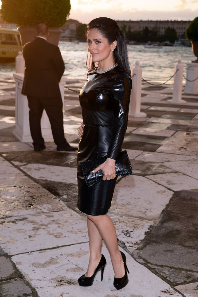 A vampish Salma Hayek also attended a stylish Venice dinner in a Bottega Veneta glossed leather dress and clutch.