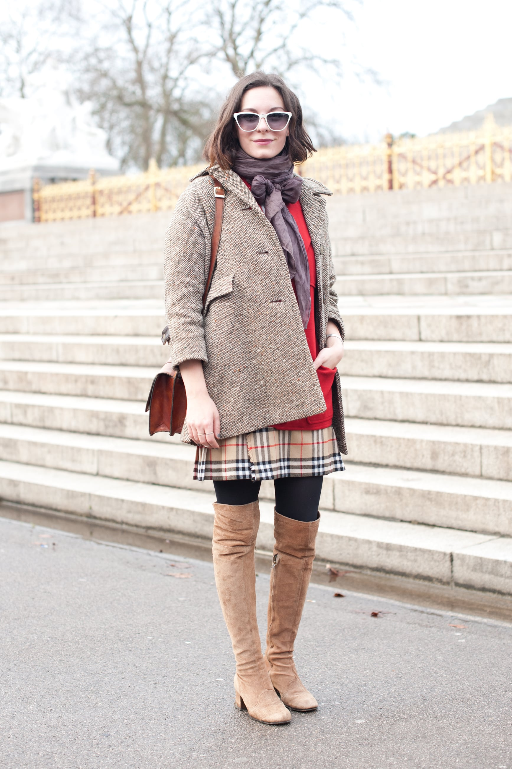"""Her coat says """"his,"""" but those boots are all hers."""