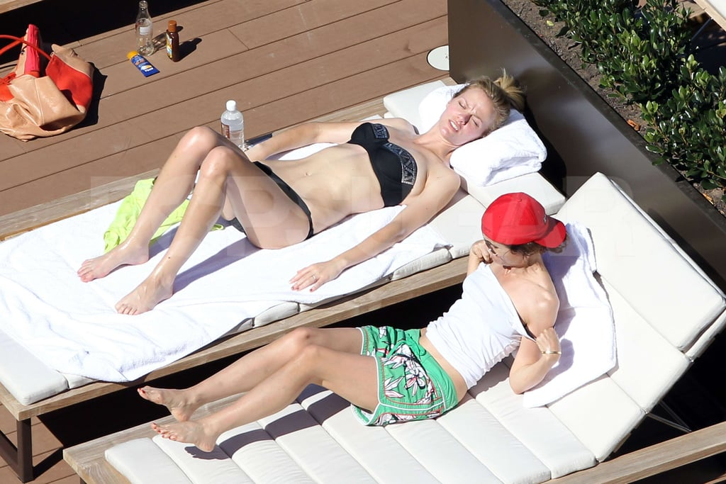 Brooklyn Decker laid out by the pool in Australia.