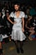 Rihanna shined bright in a silver fit-and-flare dress and black flatforms at the Opening Ceremony show.