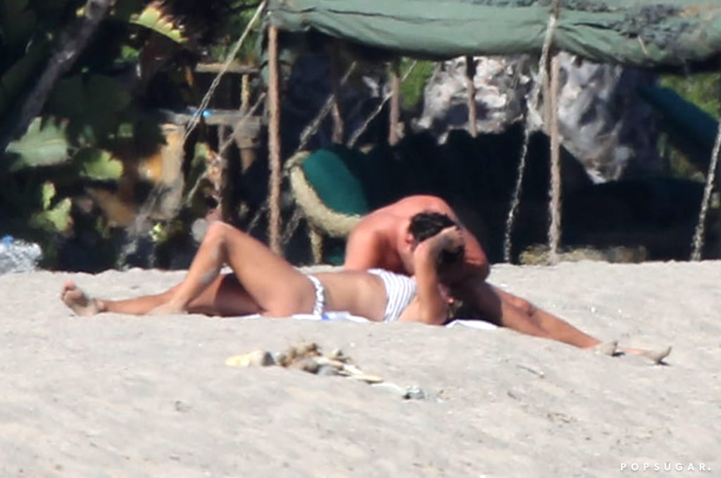 In July 2016, Leonardo DiCaprio and Nina Agdal heated up the beach in Malibu, CA, with their steamy PDA.