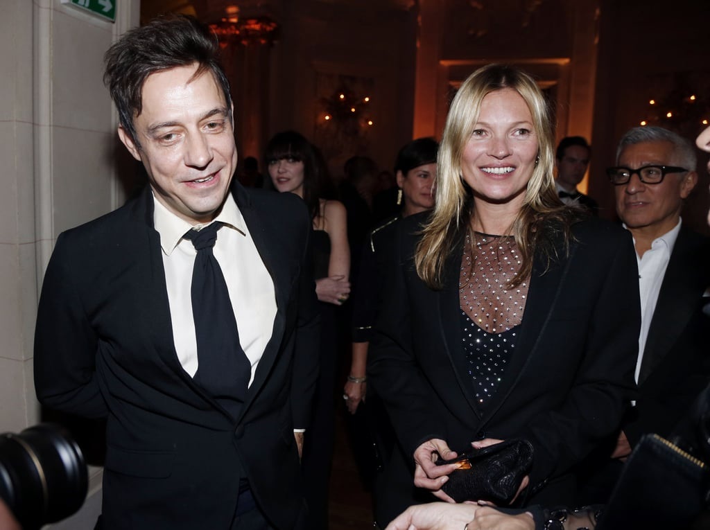Jamie Hince and Kate Moss mingled inside the CR Fashion Book launch party on Tuesday night in Paris.