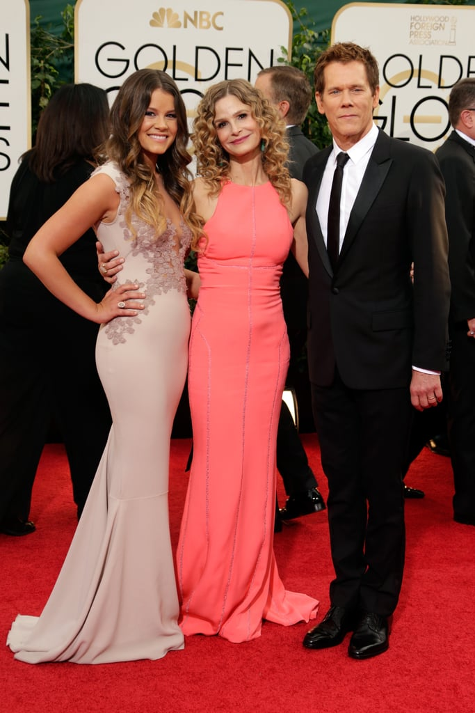 Kyra Sedgwick and Kevin Bacon hit the red carpet with their daughter, Sosie. Sosie served as Miss Golden Globe during the ceremony.