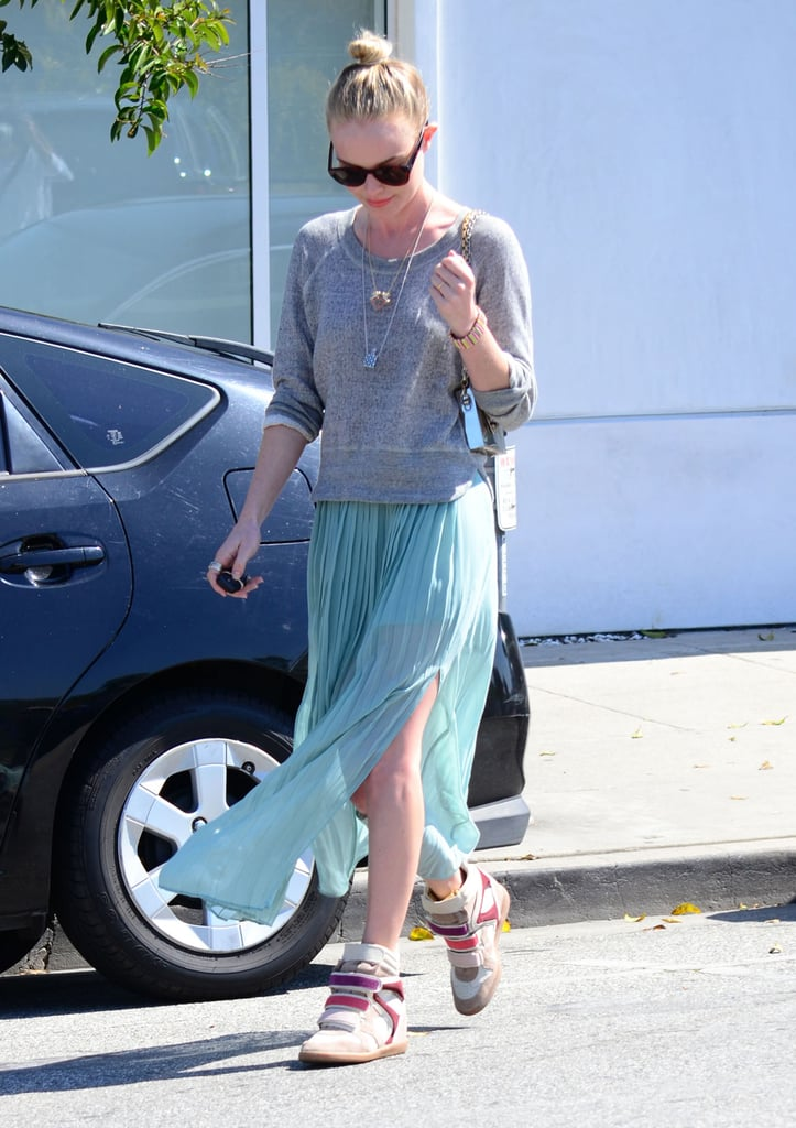 Kate Bosworth showed off her summertime LA style with a flowy maxi skirt, a slouched sweatshirt, and the best piece, her tricolored Isabel Marant sneakers.