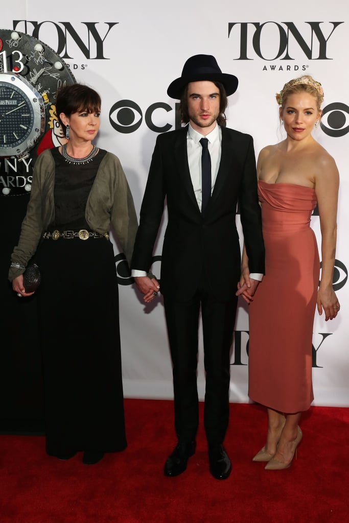 Tom Sturridge held hands with his fiancée, Sienna Miller, and his mom on the red carpet at the Tony Awards in NYC.