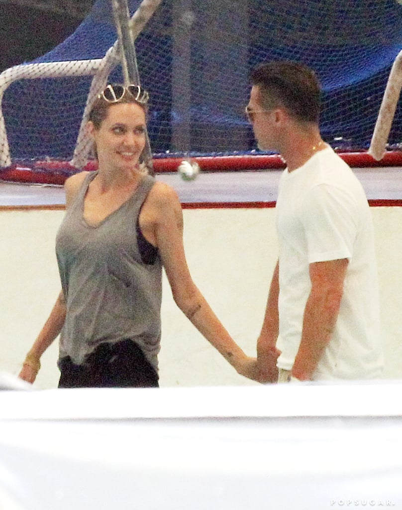 Angelina Jolie and Brad Pitt shared a cute moment at the ice skating rink during an outing with their kids in Australia on Monday.