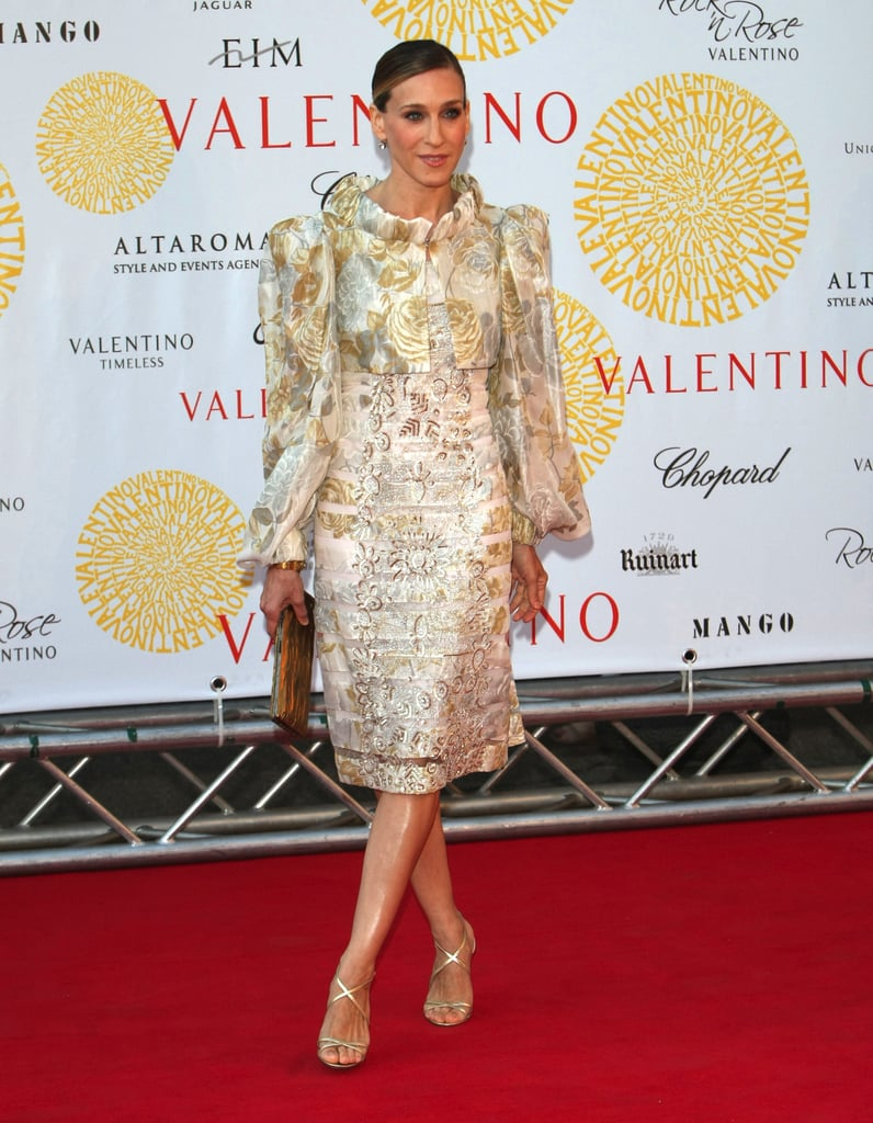 For the opening of Valentino in Rome, 45 Years of Style, SJP topped her gold gilded dress with an embroidered puff-sleeved Elizabethan shrug.