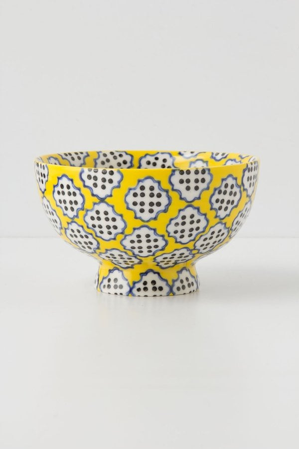 How playful is the pattern of this tiled and dotted yellow bowl ($10)?