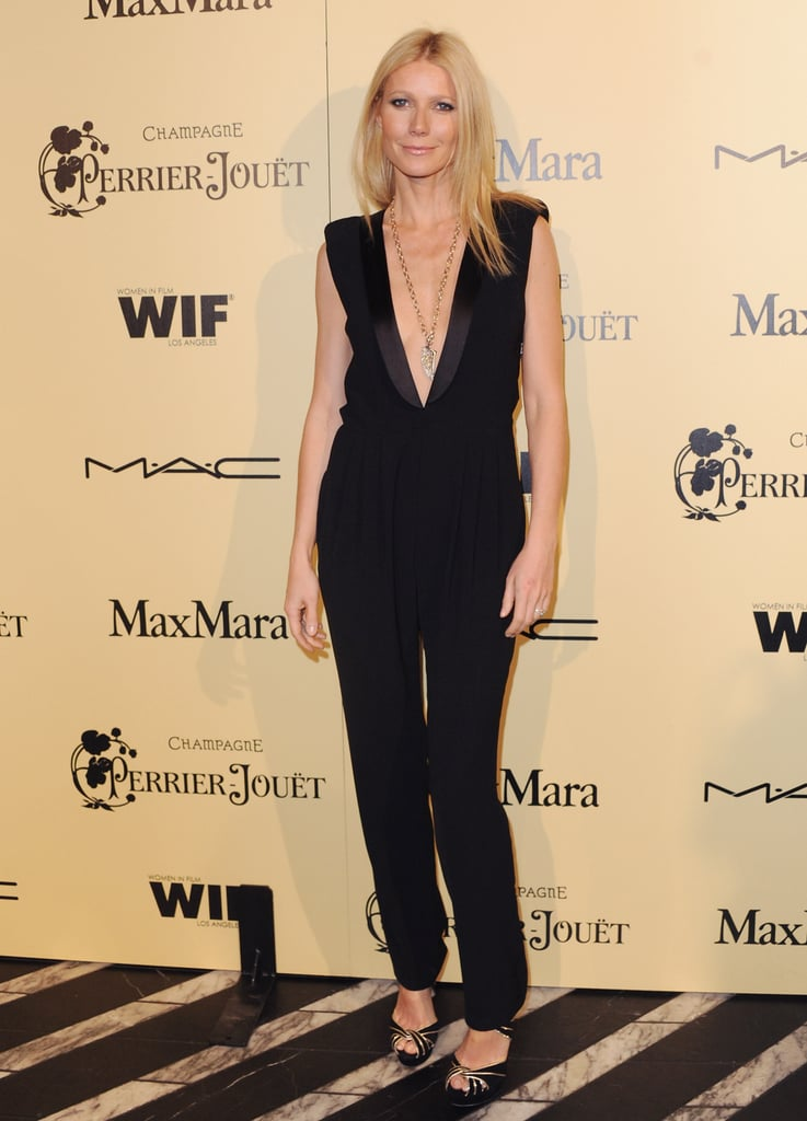 At the fifth annual Women in Film Pre-Oscar Cocktail Party in LA, Gwyneth went dramatic in a plunging Boy. by Band of Outsiders jumpsuit and gold-piped Jimmy Choo sandals.