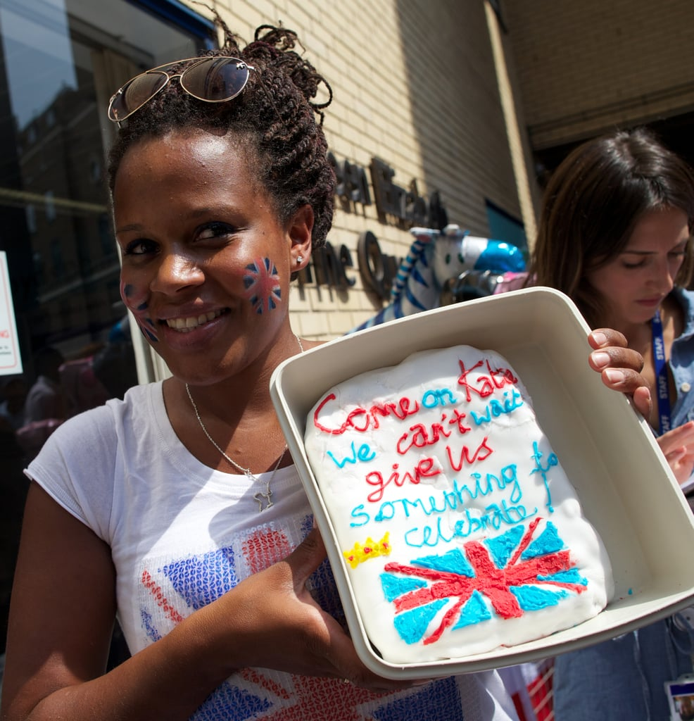 """One woman brought a cake with the message, """"Come on, Kate, we can't wait, give us something to celebrate!"""""""