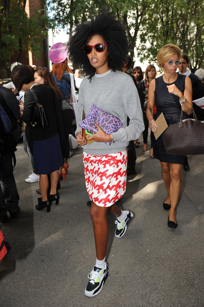 Julia Sarr-Jamois is the picture of sporty elegance as she headed into Emporio Armani. We can't decide what we love more: her printed skirt or her neon-infused Nike Air Max sneakers.