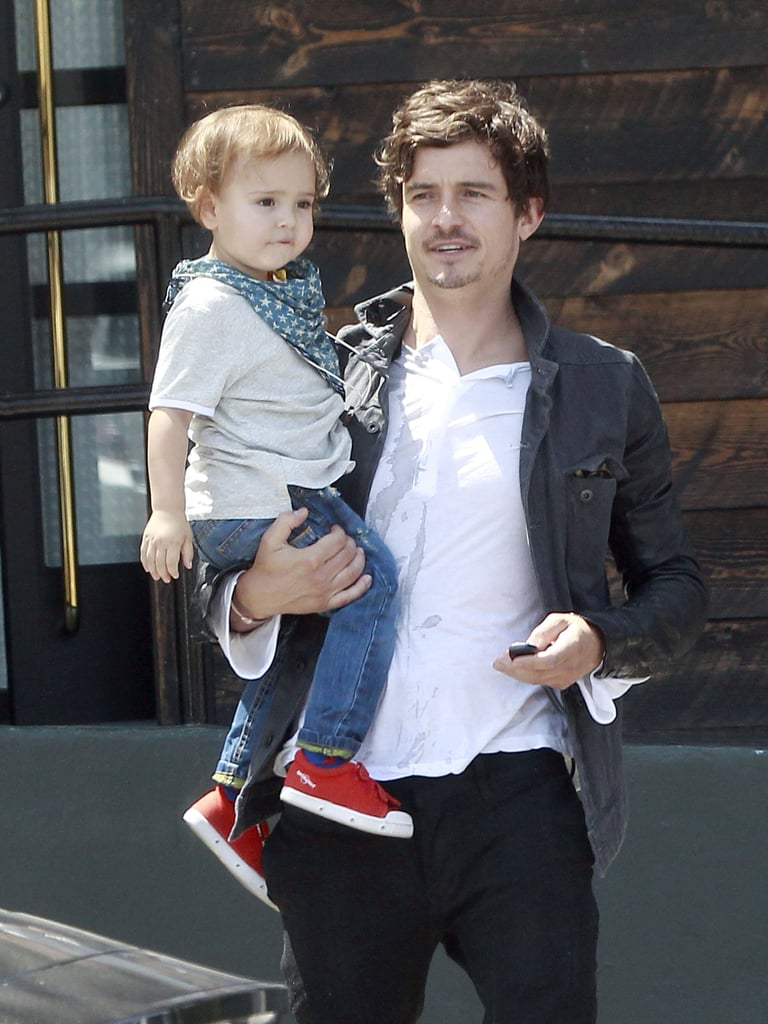 Orlando Bloom and his cowboy Flynn went out for Sunday brunch before swinging by a clothing store in LA.