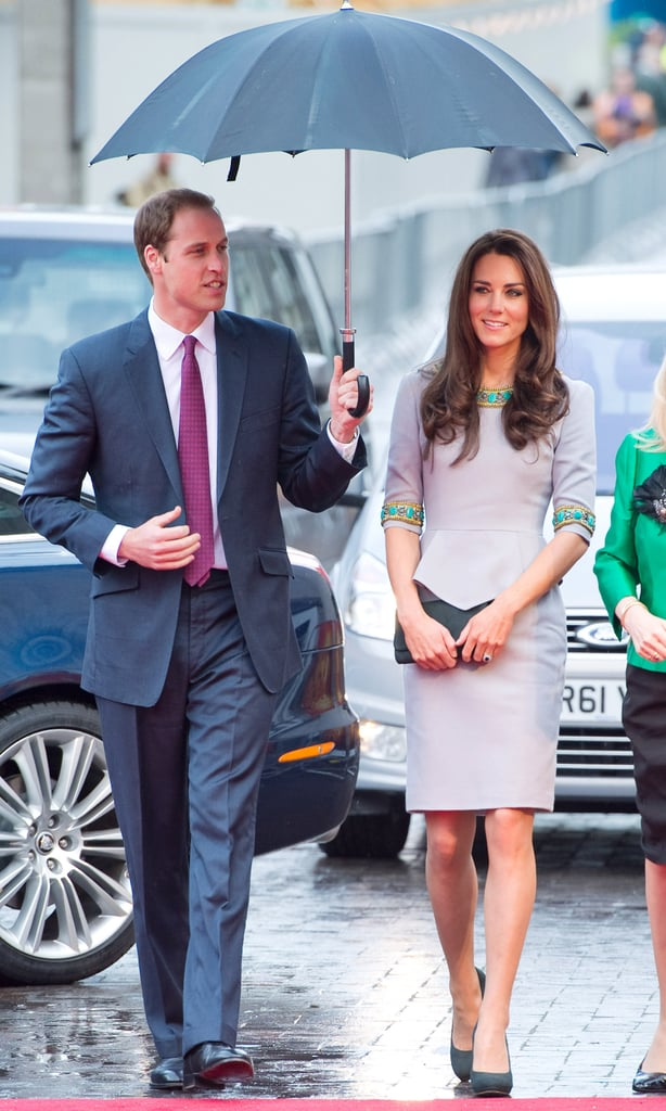 Prince William shielded Kate Middleton from the rain when they dropped by the premiere of African Cats in London in April 2012.