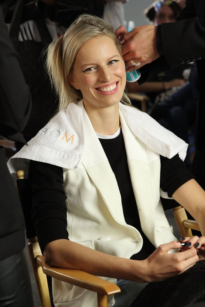 Karolina Kurkova beamed while a stylist put finishing touches on her hair at the Cushnie et Ochs event on Friday.