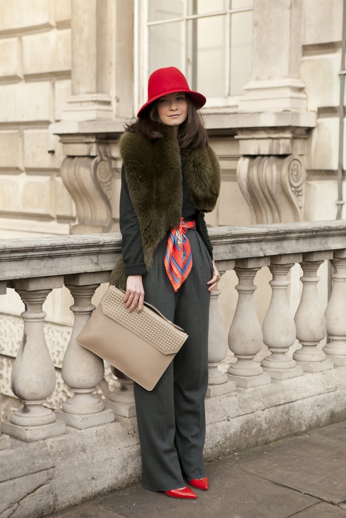A luxurious fur collar and pops of apple red set the tone for a standout outfit mix.