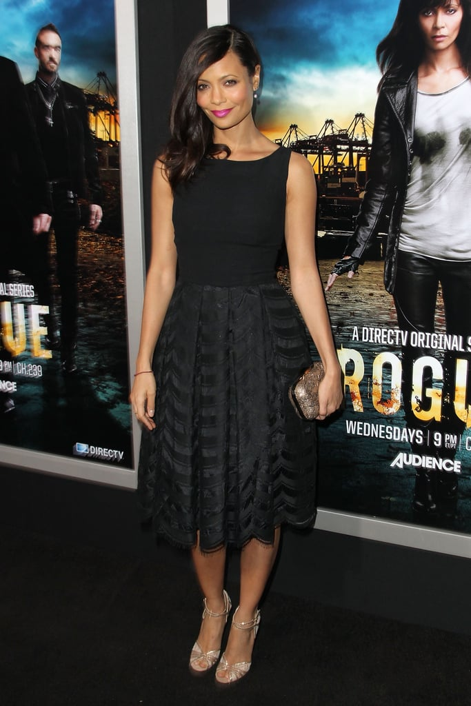 For a retro-chic feel, dress your bridesmaids in a little black fit-and-flare dress like the vintage one Thandie Newton wore to the Rogue premiere in LA. Add gold accessories and a bright lip for a pop of colour.