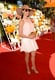 Minnie Driver's Veuve Clicquot Polo Classic ensemble included a little white ensemble by Ella Moss and tan accessories, including a glamorous floppy hat.