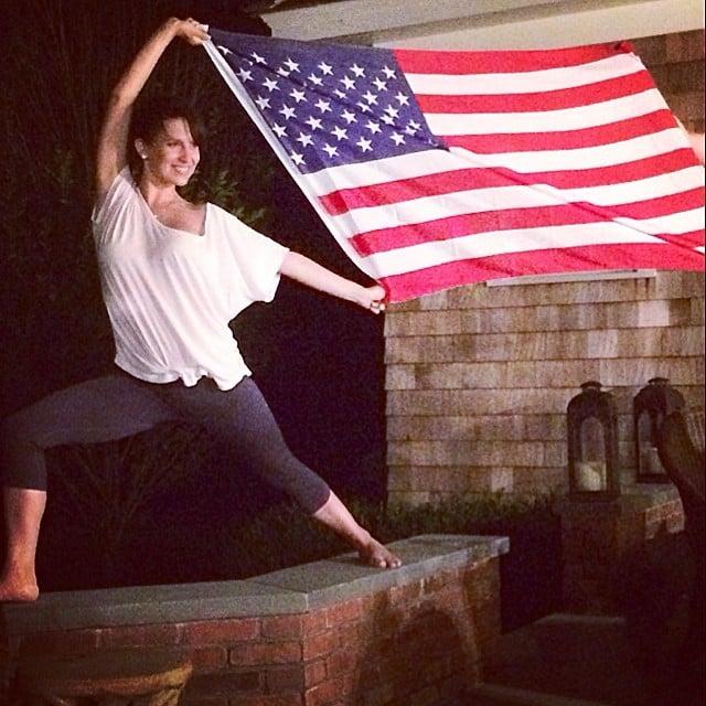 Hilaria Baldwin showed off her yoga skills with a giant flag. Source: Instagram user hilariabaldwin