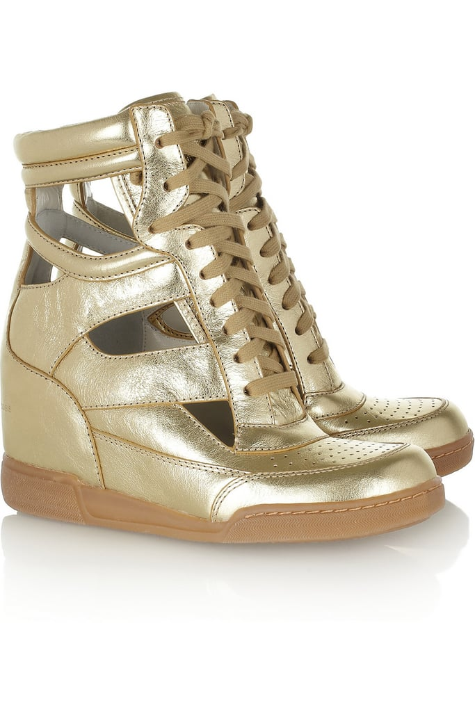 Make sure a wedge sneaker is in your wardrobe! We love Marc by Marc Jacobs's glitzy metallic cutout pair ($164, originally $328).