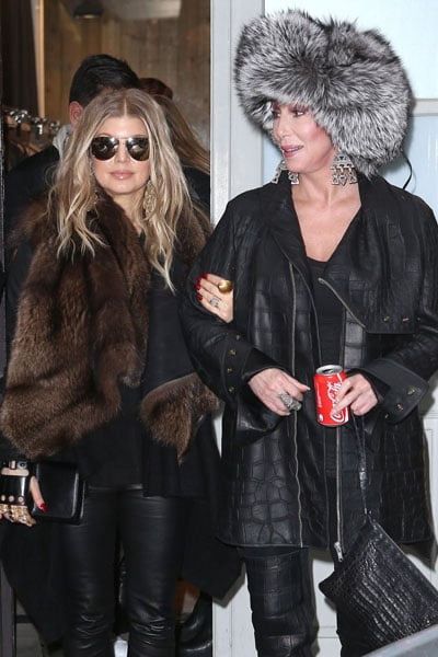 Fergie and Cher matched with fur while in Paris for Fashion Week in February.
