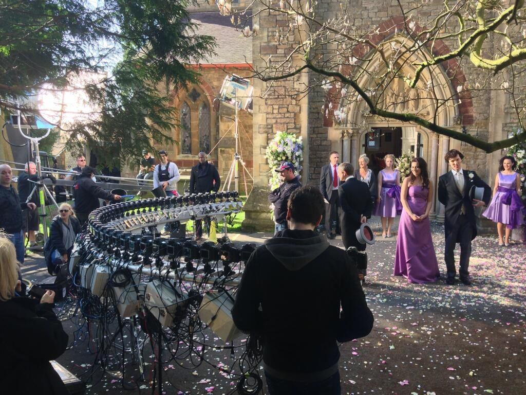 """""""What do you mean you didn't press the shutter!"""" From Steve Lawes, director of photography on the second episode, """"The Sign of Three,"""" with a totally different perspective on the flashing cameras when Watson and Mary emerge from the church on their wedding day.  Source: Twitter user SteveLawes"""