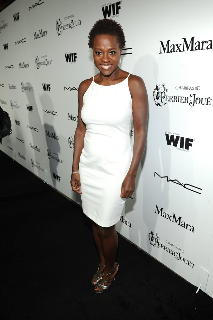Viola Davis was sleek in a little white Max Mara dress and metallic sandals at the Women in Film Pre-Oscar cocktail party.