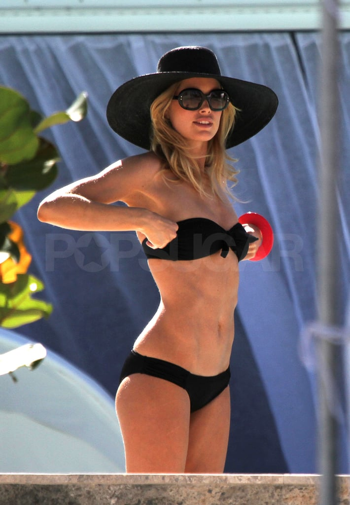 Doutzen adjusted her bikini top.