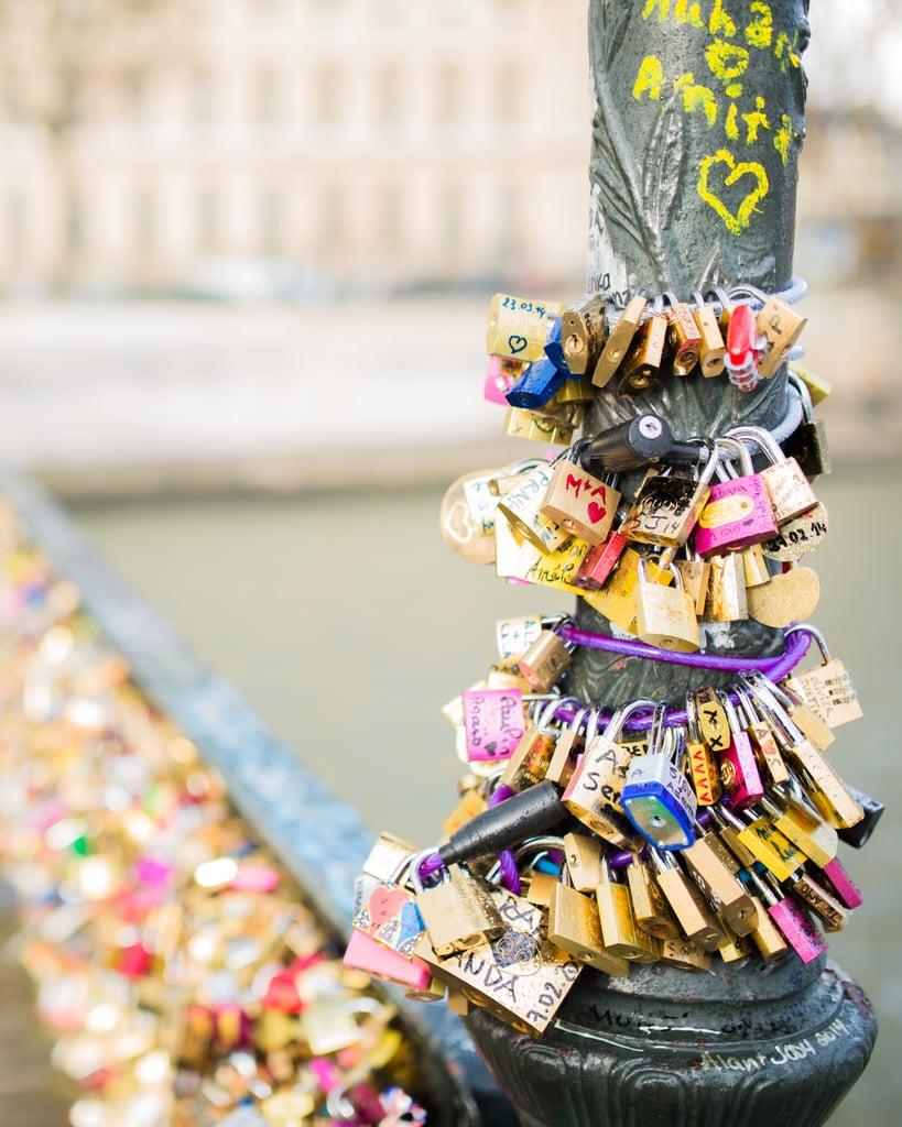 Locks covered the Bridge of Arts (Pont des Arts) in Paris.