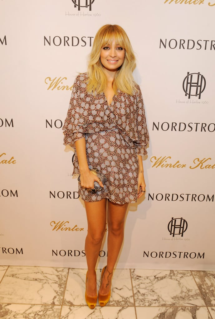 Nicole posed for photos at the House of Harlow and Winter Kate event.