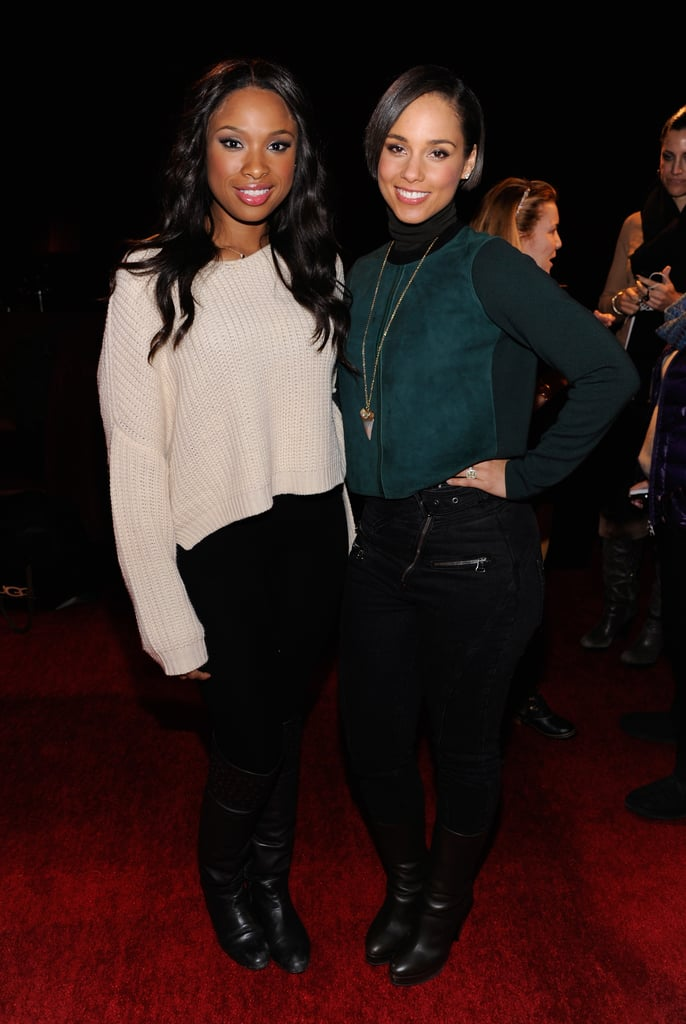 Now this is a dynamic duo: Jennifer Hudson, in a slouchy sweater and black jeans, and Alicia Keys, in a luxe green turtleneck and black jeans, posed together at the Village at the Lift.