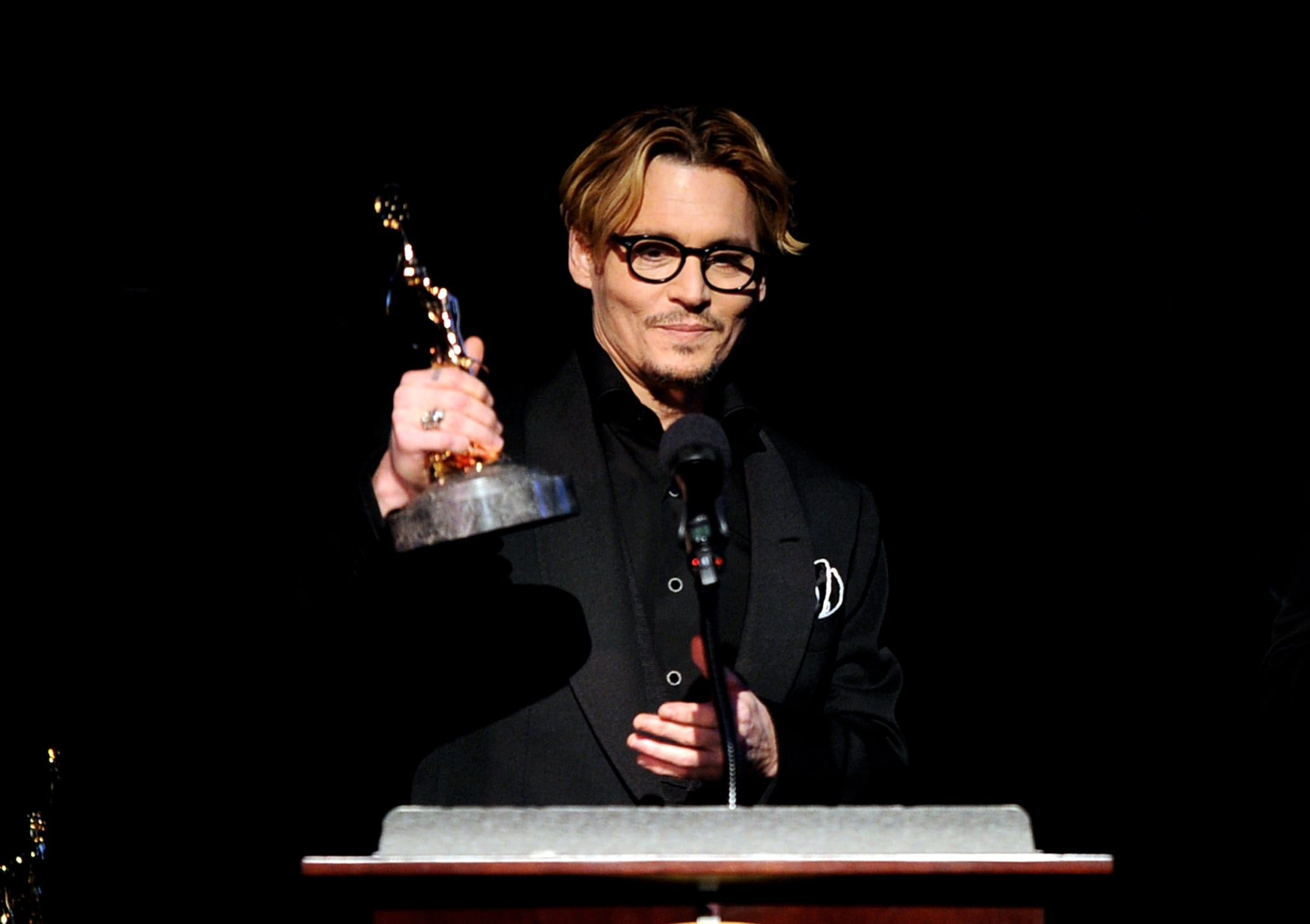 Johnny Depp received the distinguished artisan award at the Make-Up Artists and Hair Stylists Guild Awards in LA on Saturday.