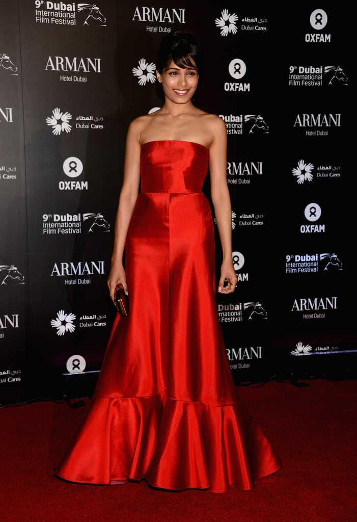 Freida Pinto hit the red carpet in a bold shade of red.