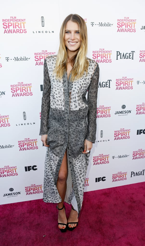 Dree Hemingway revealed a little leg in a floor-length print dress from Calvin Klein Collection Resort 2013 and paired it with simple black sandals, also by Calvin Klein.