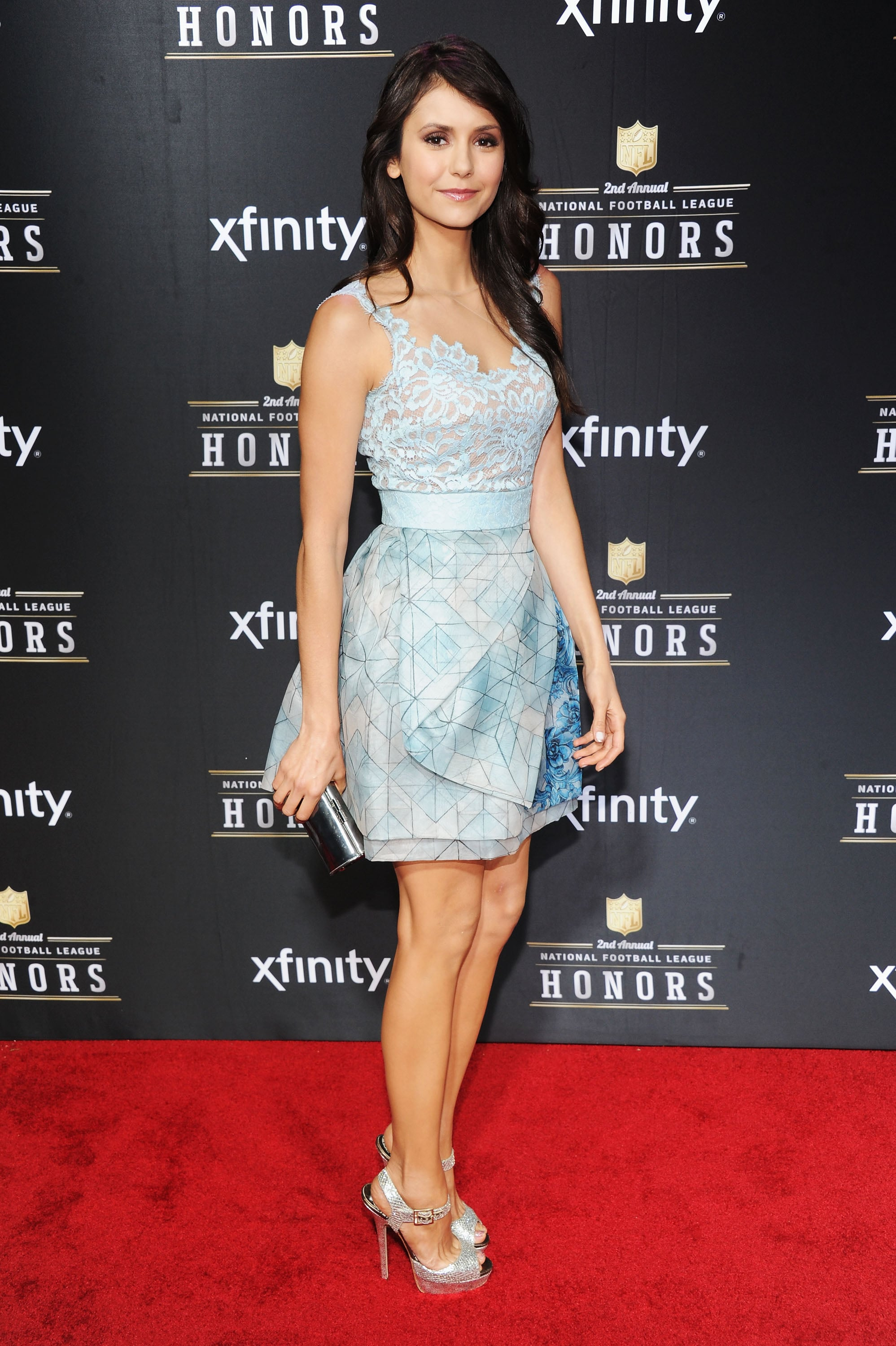 Nina Dobrev, who played in DirecTV's celebrity beach bowl earlier in the day, chose a sweet light-blue Zuhair Murad mini and silver Jimmy Choo sandals for the NFL Honors event. But The Vampire Diaries star's dress was anything but simple: her lacy floral top and geometric-print A-line skirt proved doubly dynamic.