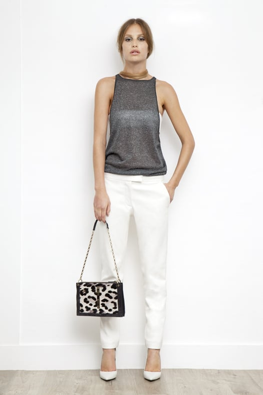 Lurex Low Side, High Neck Tank in Silver ($195), Leather Bandeau in Cream ($350), Slim Pant in Cream Wool ($595), Addiction Nappa Pump in Cream ($550), Attraction Pony Shoulder Bag in Grey/Cream Leopard ($1,995) Photo courtesy of Tamara Mellon