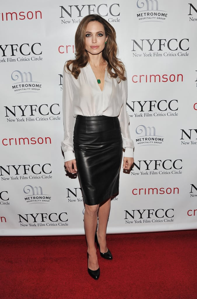Understated sexy at it's best: silk blouse + leather pencil skirt. This killer combo was 100% Angelina at the New York Film Critics Circle Awards in January of 2011.