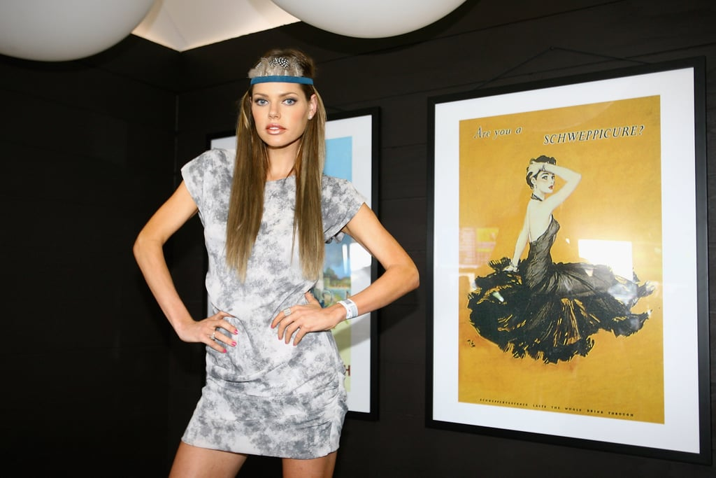 Sophie Monk tries on a Pocahontas inspired feathered head piece.