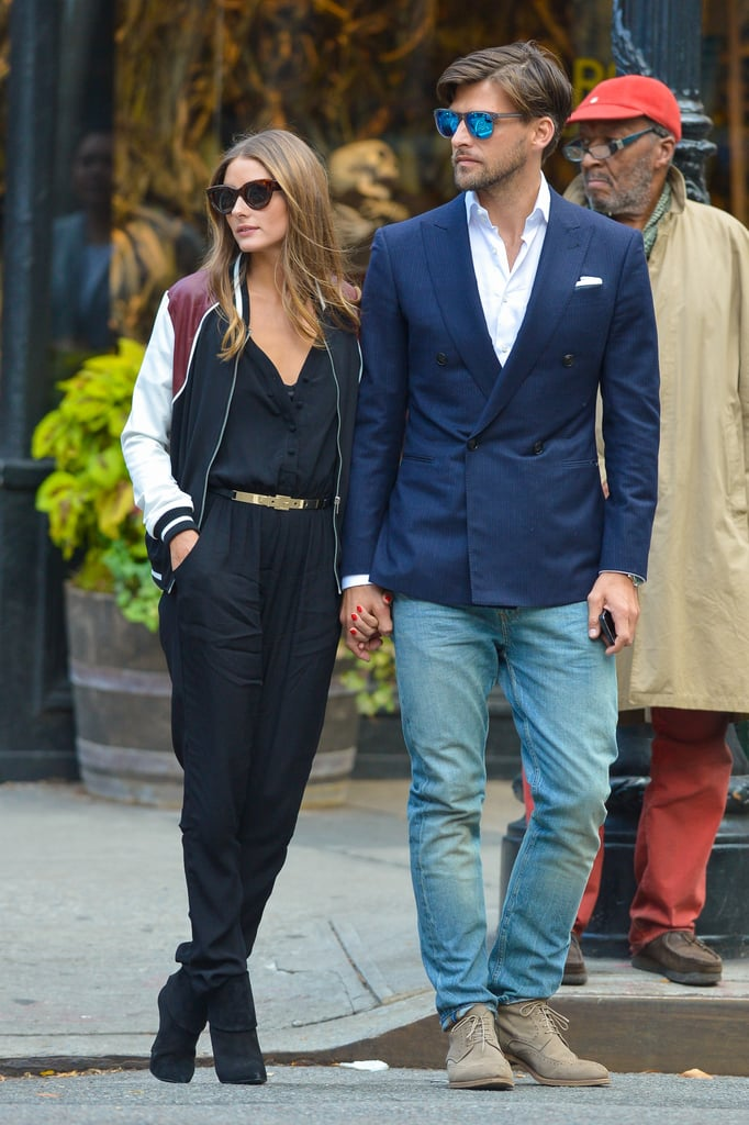 While hanging with Johannes Huebl in November, Olivia outfitted a chic jumpsuit with a sporty varsity jacket.