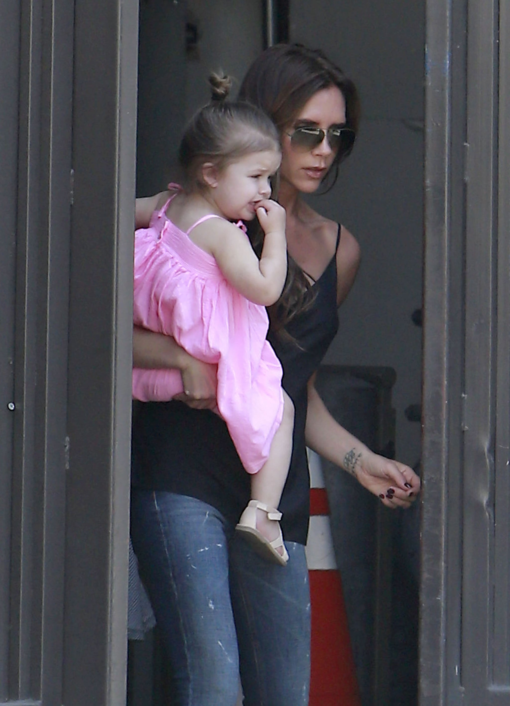 Victoria Beckham carried her daughter, Harper, in LA.