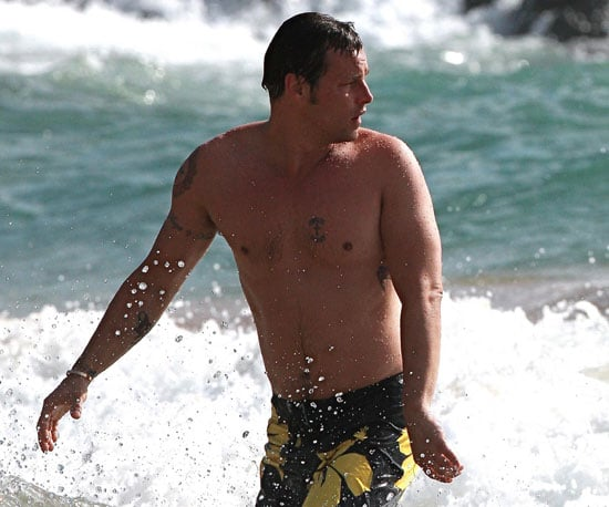 Slide Photo of Justin Chambers Shirtless in Hawaii Wearing Yellow Floral Board Shorts
