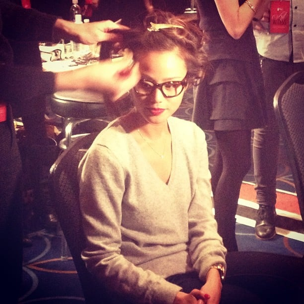 Jamie Chung wore adorable glasses and a poppy red lip to match her red dress at The Heart Truth's Red Dress Fashion Show.
