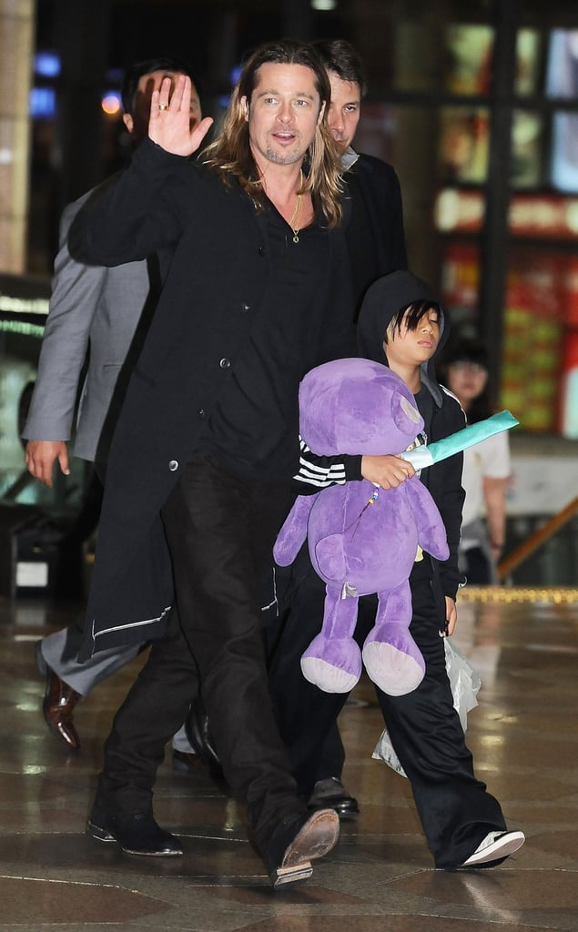 Brad Pitt and Pax departed from Seoul, South Korea, late Tuesday night.