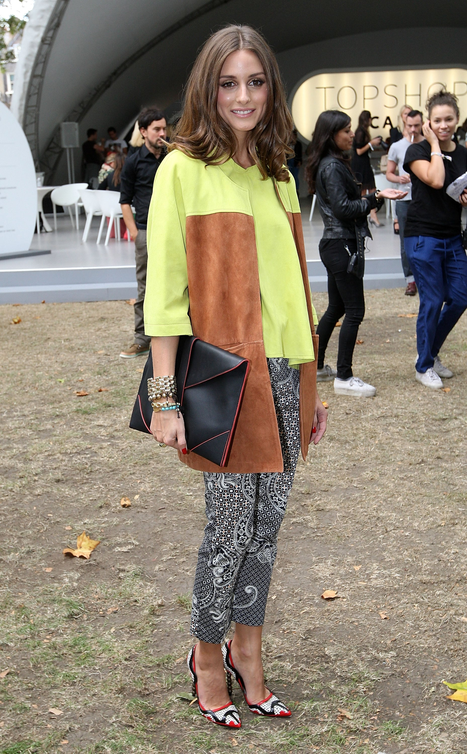 As only Olivia can, she mixed bold statement color, texture, and print on her Simonetta Ravizza top and Topshop pants with ease for the Topshop Unique show at LFW.
