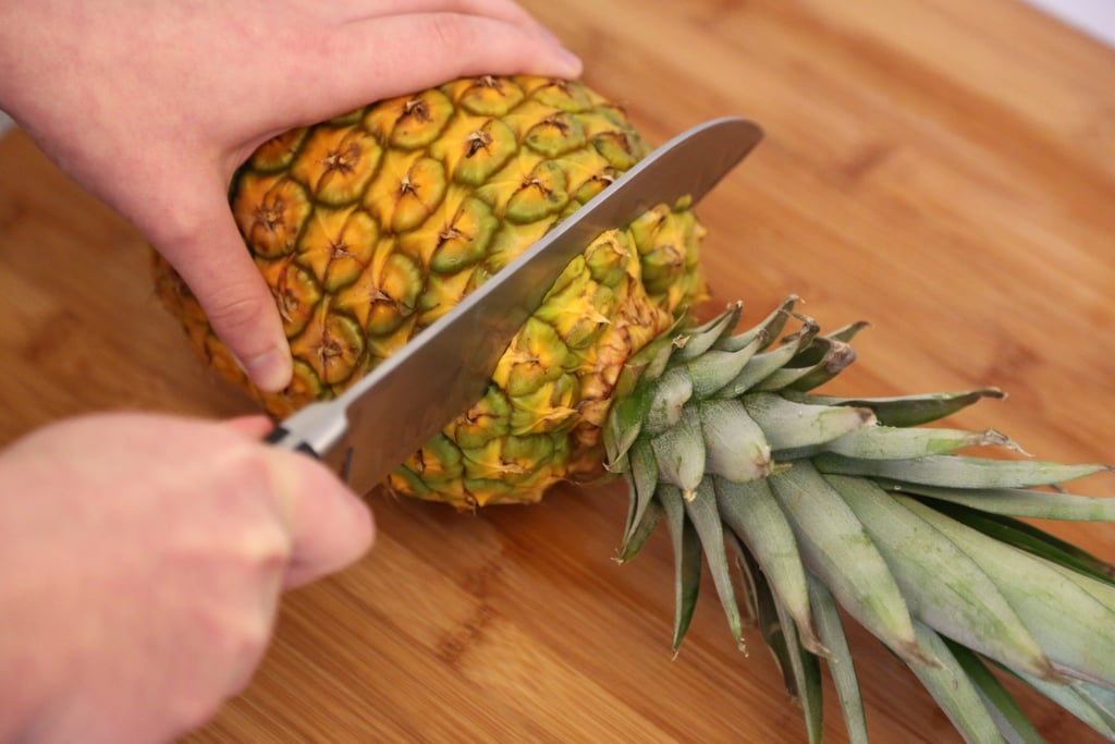 Lay the pineapple on its side and cut the top.