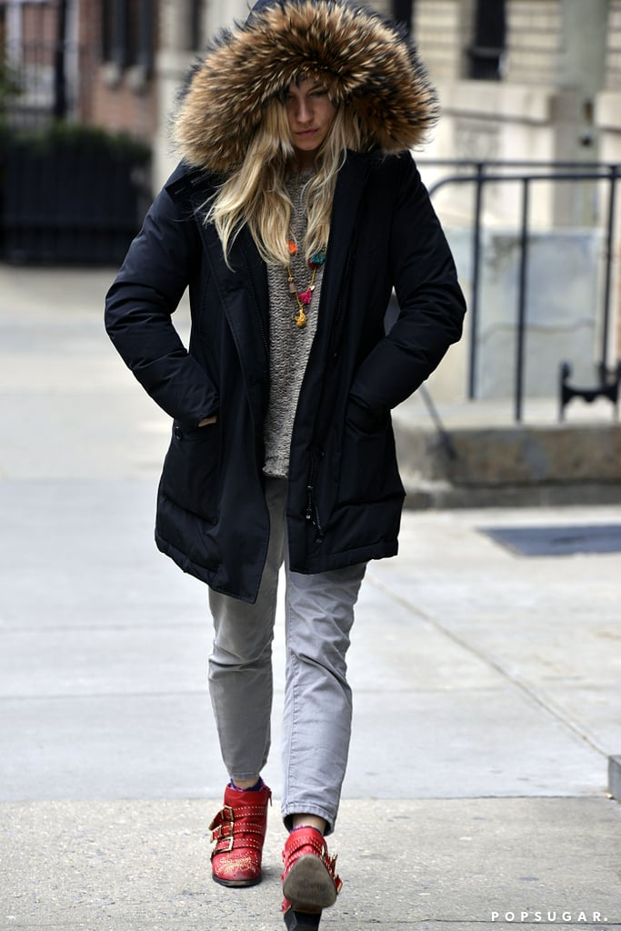Sienna Miller donned a furry parka.