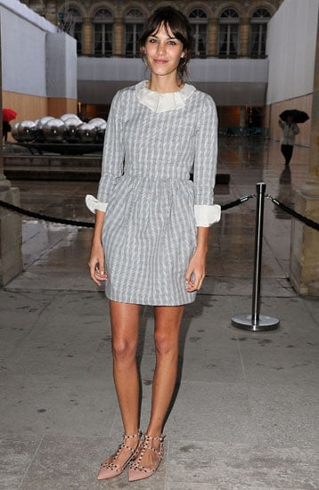 Looking sweet in a pale blue check dress and studded Valentino flats during Paris Fashion Week.