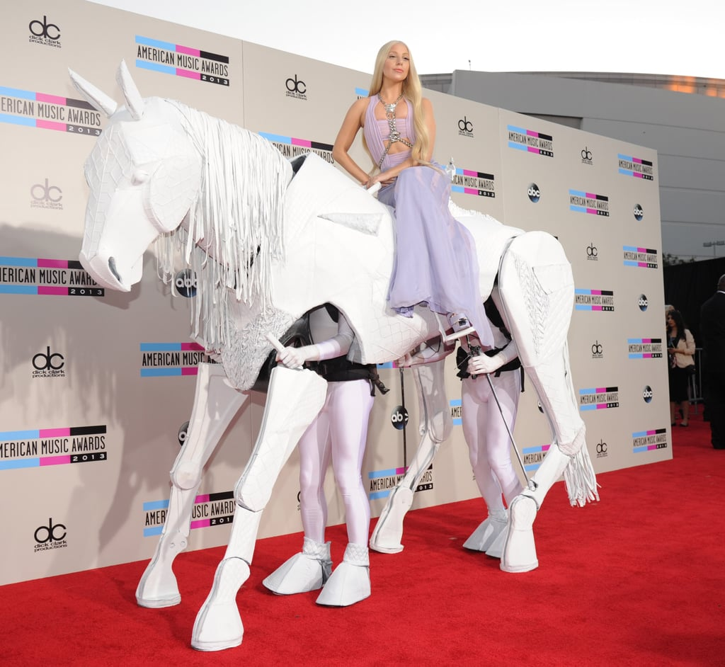 She Arrived at the 2013 AMAs Riding a Human Horse