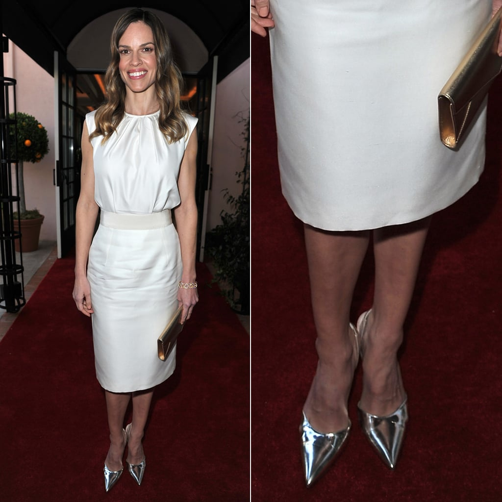 Hilary Swank's white sheath dress got a pop of shine via her metallic silver pointy pumps at the Montblanc and UNICEF pre-Oscar brunch in Beverly Hills.