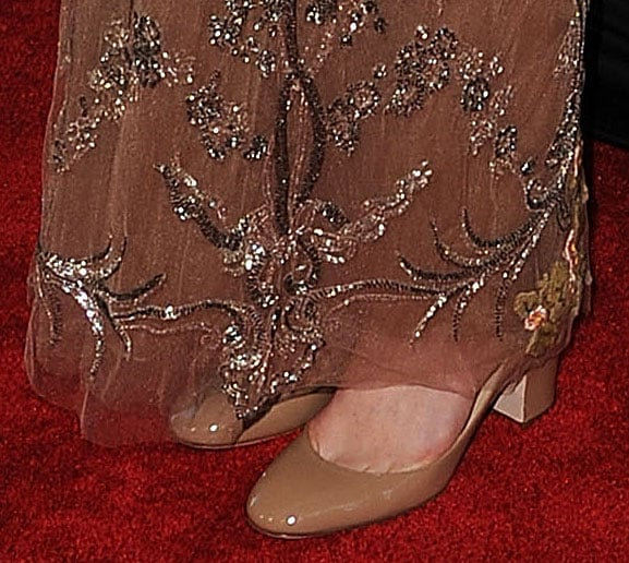 The embellishment continued right down to her toes on a delicate sheer overlay.