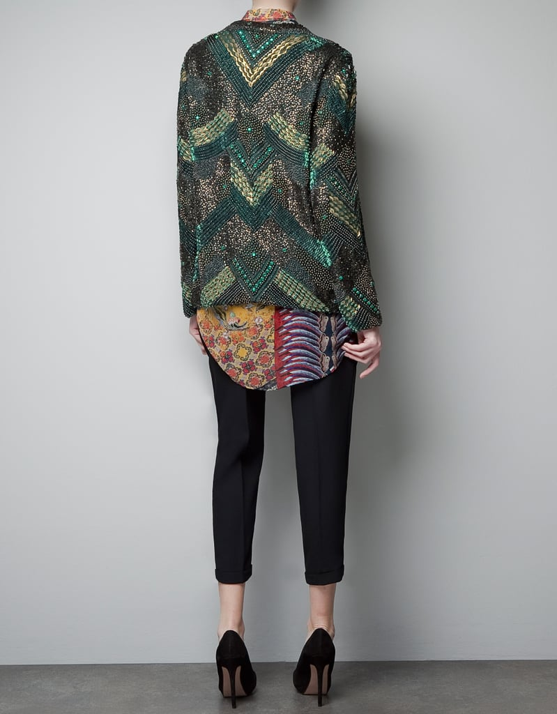 Zara's sequined embroidered cardigan ($399) can easily dress up slouchy jeans and a tee in no time at all.